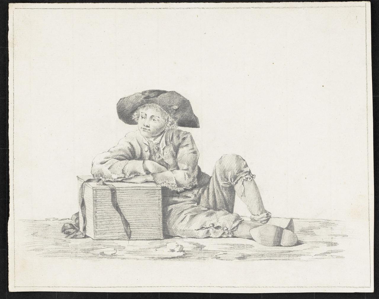 Studie zittende jongen op klompen, steunend op doos