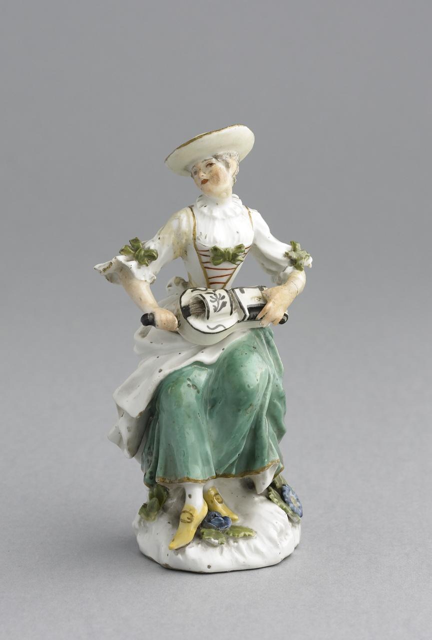 Meerkleurig beeldje van een vrouw met een draailier, Meissener Porzellan Manufaktur